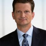 KPMG Re-Elects William Thomas as Chairman and CEO